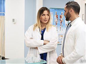 physician and nurse Blair Williams pummel in polyclinic