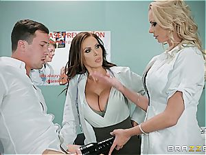 physician Nikki Benz and nurse Briana Banks treating a thick stuck dick