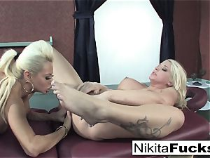 Nikita gets a calming massage from Leya