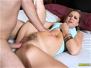 Miss Melrose deep throats his rigid prick while she gropes her bud