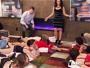 Swingers join a sexuality act before heading to the crimson apartment