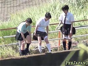 asian teens urinating