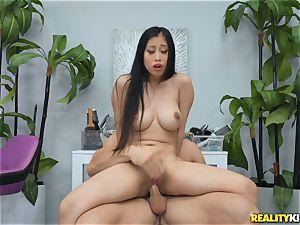 Jade Kush riding on a rigid trunk