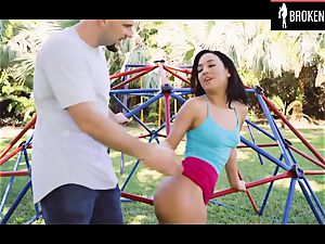crazy black-haired teenage smashed on a playground